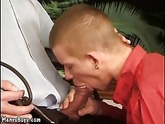 Young lad throws his legs up for a hung old man