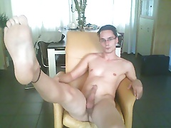 Young guy shows his feet and cums in the chair