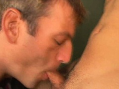 Hefty blonde gay Giovanny giving blowjob to a handsome dude