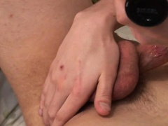horny young guy jerks off his dick and cums on his torso