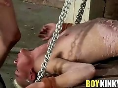 Sexy twink Titus Snow stripped naked and roped to a pallet